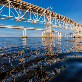 Reflections of a Bridge by Carol Ward - Buildings & Architecture Bridges & Suspended Structures ( annapolis, chesapeake bay bridge, maryland, reflections, bridge spans, architecture, bridge, underneath )
