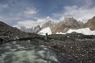 Photo: Looking back towards the Trango and Cathedral groups from a makeshift bridge across a stream on the surface of the Baltoro Glacier.