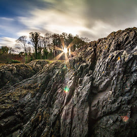 A glimmer of light by Danny Charge - Landscapes Prairies, Meadows & Fields ( rock, love, sky, coast, sunrise, coastline, rocks, sunshine, belfast, sun, trees, landscape )