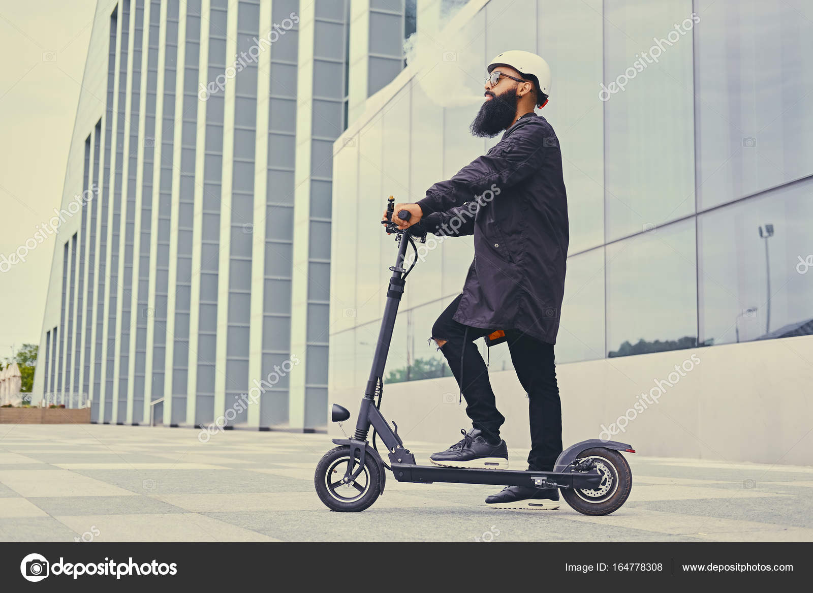 hip guy riding a scooter