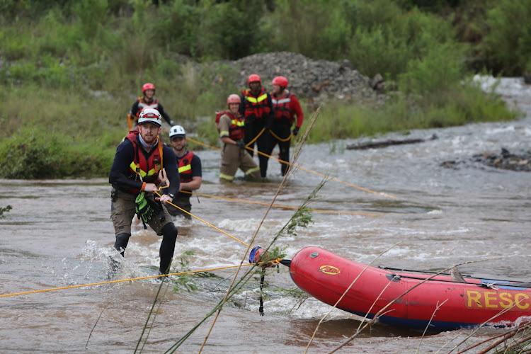 Search and rescue teams retrieve the body of a man, on January 26 2021, on the Blyde River near Pilgrims Rest, Mpumalanga, after a two day search.
