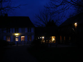 Photo: The main house at dawn. There are actually only a few small chestnut trees on the property; we were told that the former owner went a little crazy in his old age, and chopped them all down.