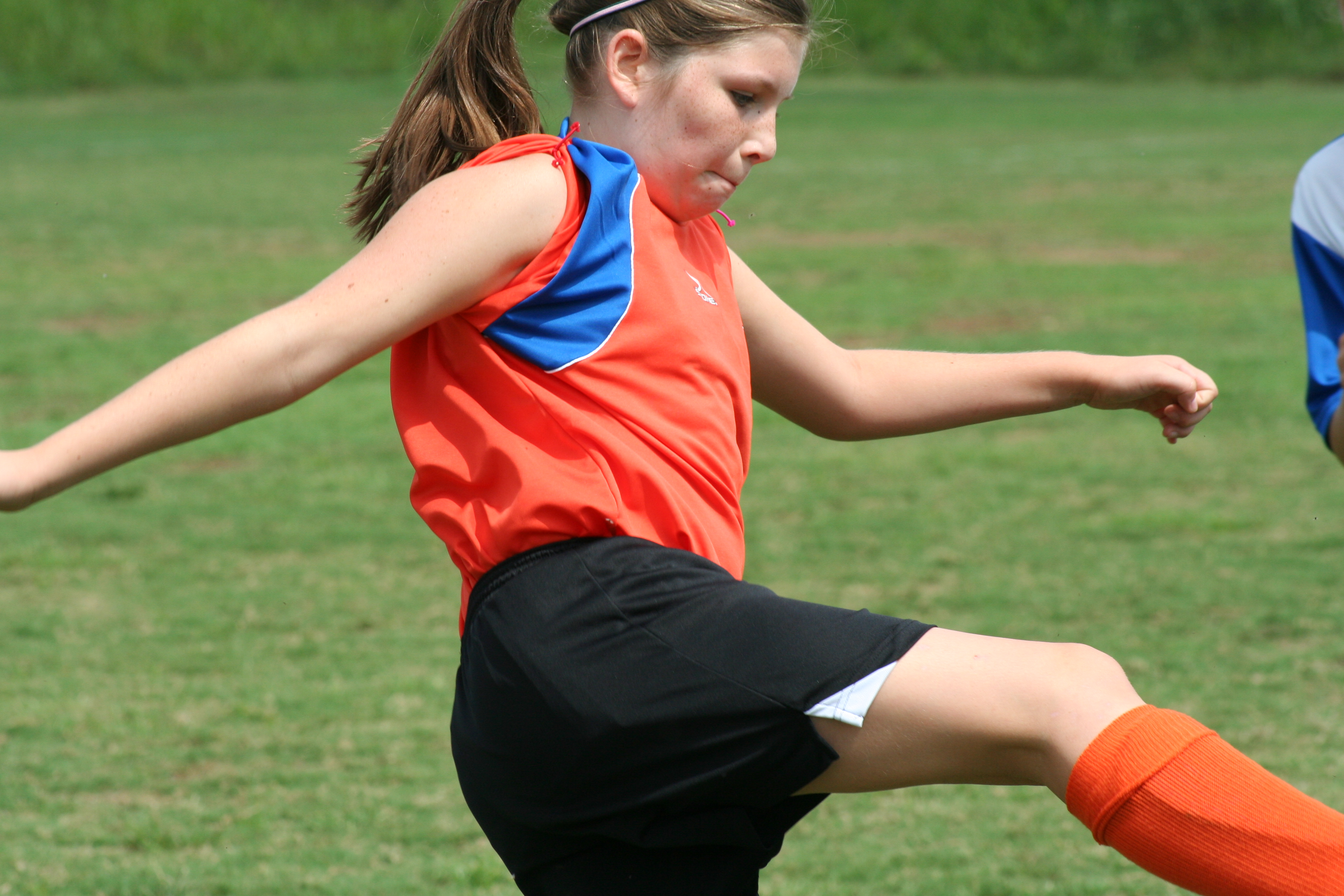 The athlete diet helps a young girl playing soccer -- Eat Like a Champion sports nutrition class.