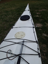 Photo: Deck bungee near bow to hold greenland paddle. Reflective perimeter lines.
