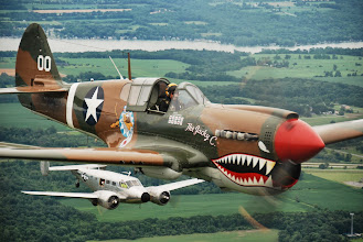 Photo: Pilot Thom Richard, Curtiss P-40 Warhawk. Please visit http://www.americanairpowermuseum.com and C-45