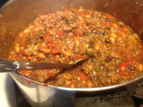 Now add in the remaining canned veggies and spices, stir to mix together. Continue...