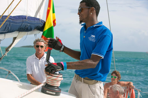 grenada-shadowfax-crew.jpg - A crew member aboard Shadowfax during a tour along Grenada's western coastline.