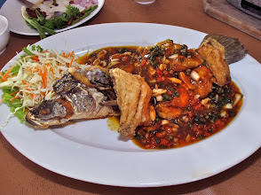 Photo: crisp-fried barramundi fish topped with spicy black pepper sauce