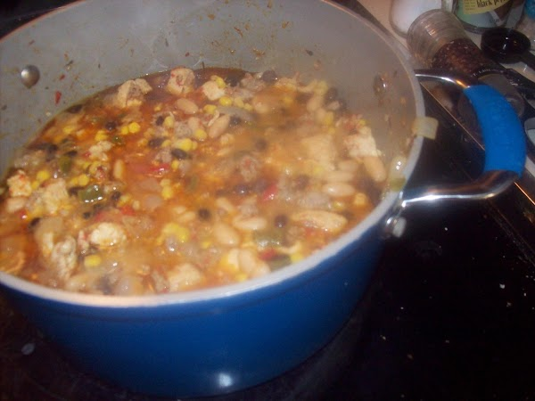 Add in chicken broth, corn, cannellini beans, black beans  and evaporated milk to...
