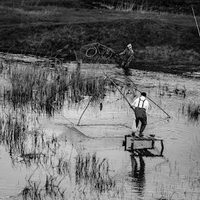 Fishing by Nicolau Flavius-Alin - Black & White Portraits & People
