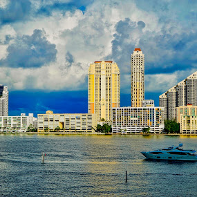 Daytime on the Intracoastal by Neil Dern - City,  Street & Park  Vistas ( landscapes, waterscape, early afternoon, buildings, boat )