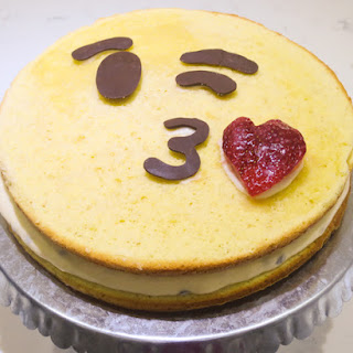 Passion Fruit Cake with Kiss Throwing Emoticon decoration.