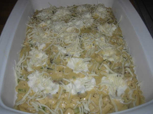 Put 4 noodles on the bottom of the greased pan.  Layer with 1/3...