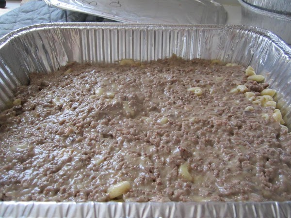 Next layer 1/2 of meat mixture and gently spread over macaroni.