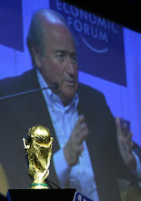 Photo: DAVOS/SWITZERLAND, 26JAN06 - Joseph S. Blatter, President, F'd'ration Internationale de Football Association (FIFA), Switzerland and his FIFA Trophy, captured during the session 'Can a Ball Change the World: The Role of Sports in Development' at the Annual Meeting 2006 of the World Economic Forum in Davos, Switzerland, January 26, 2006. 