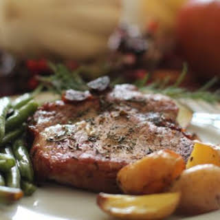 Baked Pork Chops with Rosemary, Apples and Caramelized Onions.