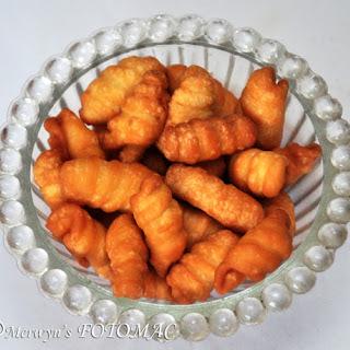 Kulkuls (Traditional Goan Sugar Glazed Curls).