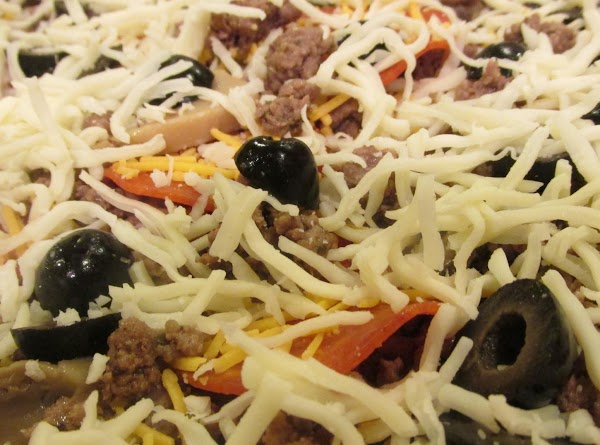 Repeat with remaining cheese, but reserve about 1/2 cup of shredded mozzarella for the...