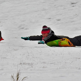 Flying Down The Hill by Kathy Woods Booth - Babies & Children Children Candids ( winter, playing, children candids, snowy, fun, children photography )