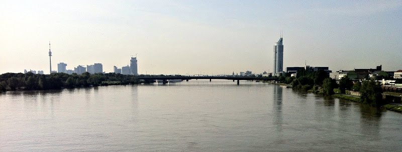 """Photo: A view downstream from the final bridge that I cross. The tall tower to the left is the """"Donauturm"""" where I got married in 2006! http://en.wikipedia.org/wiki/Donauturm"""