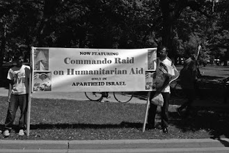 "Photo: A placard that reads ""Commando Raid on Humanitarian Aid."""