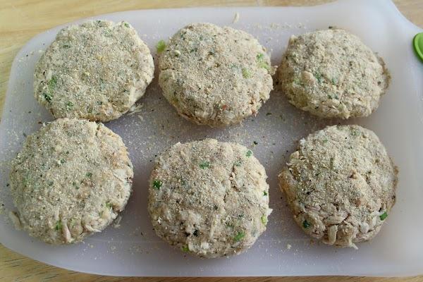 Shaping tuna mixture into six patties.