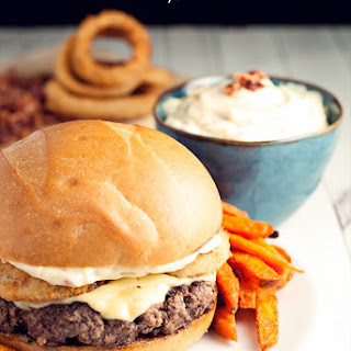 Blackened Pepper Cheeseburgers with Onion Rings and Bacon Aioli