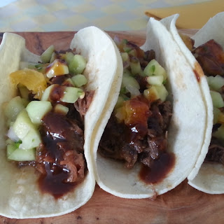 Short Rib Tacos with Southern Spicy Orange BBQ Sauce and Cucumber/Orange Salsa.