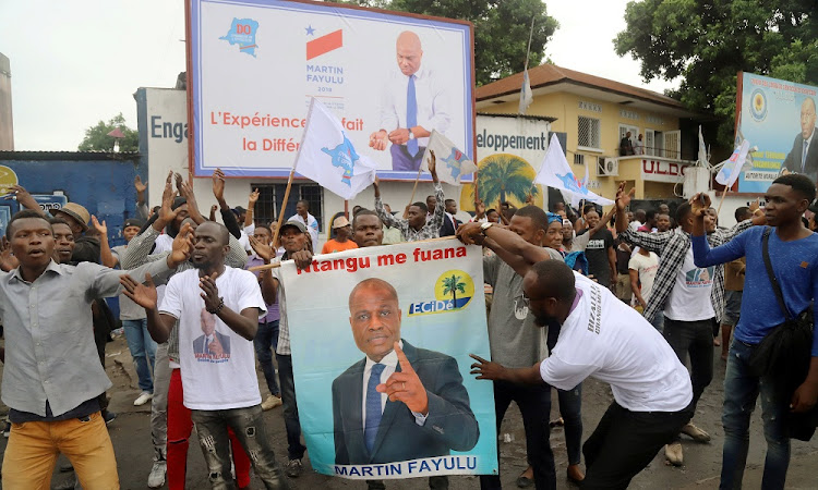 Supporters of Congolese presidential candidate Martin Fayulu celebrate after the opposition coalition chose him as their candidate for the December presidential election, in Kinshasa, DRC, November 12 2018. File photo: REUTERS/KENNY KATOMBE