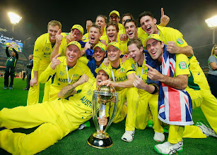 Photo: MELBOURNE, AUSTRALIA - MARCH 29:  Australia pose for a photo with the World Cup trophy after they won the 2015 ICC Cricket World Cup final match between Australia and New Zealand at the Melbourne Cricket Ground on March 29, 2015 in Melbourne, Australia.  (Photo by Scott Barbour-IDI/IDI via Getty Images)