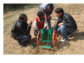 Photo: SWI drill equipment - first introduced to Nepal by FAYA Nepal. RB Khadka and SB Basnet obvserving with KGVK, Jharkhand India team). 2011 [Photo provided by RB Khadka]