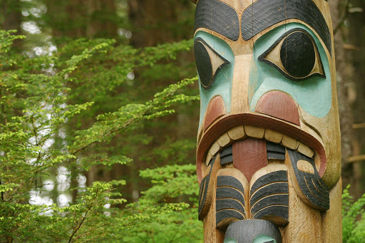 sitka-totem-in-park.jpg - At Sitka National Historic Park, wander through the forest along scenic paths where totems depict the rich culture of the Tlingit people.