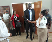 Justice & correctional services minister Ronald Lamola interacts with departmental officials at the Goodwood Correctional Centre on Wednesday.