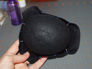 Photo: This is what it will look like from the top.    Notice how the hat is oval shaped.  Make sure the brim on the back (short) side is straight and the 2 other (long) sides angle toward the front to form a gentle point.  (The brim on this hat is very small so it won't be as pointy as Felicity's tricorn hat.)  Let the hat dry, checking it periodically for the first hour or 2 to make sure the pins don't pull out and that it's drying nicely and keeping it's shape.
