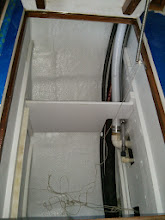 Photo: vertical divider outboard of the hot water heater shelf adds additional storage