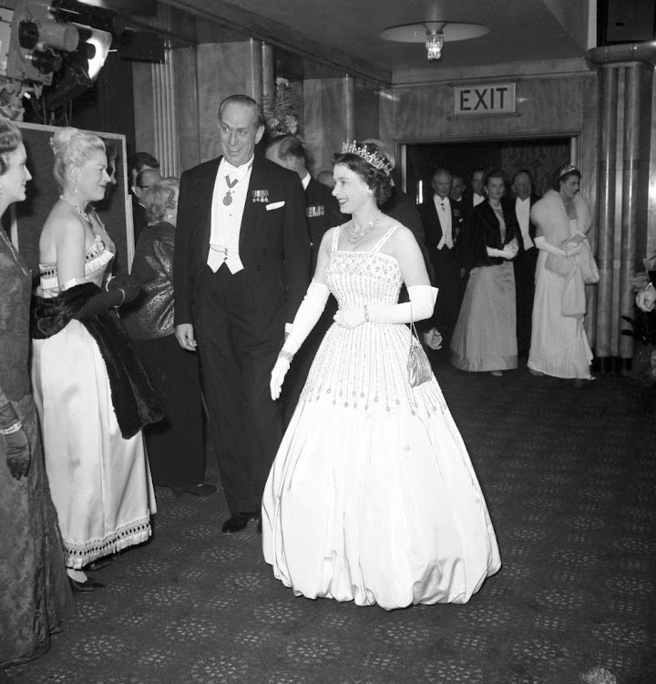 Queen Elizabeth II in the Norman Hartnell gown at the premiere of 'Lawrence of Arabia' in 1962. Princess Beatrice, above, turned this dress into her wedding gown when she married property developer Edoardo Mapelli Mozzi in July 2020.