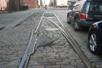 Photo: Trolley Tracks and bicyclists in DUMBO.