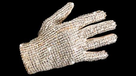 http://www.examiner.com/images/blog/EXID19726/images/michael_jackson_glove_sold_at_auction_2009_$48k.jpg
