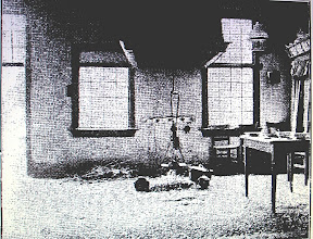 Photo: This is a very poor photo  but I wanted to include it. This shows a space in the middle of the floor for a kitchen fire, with a large hood for venting smoke above it.  Old peasant farmers' homes were without chimneys and had fireplaces like this. One half of the building was for the farmer, the other half for his livestock. At one time they didn't even have a wall between them. This is not unusual . Many European peasants used to live the same way. Some had animals on the ground floor and people above them on the next.
