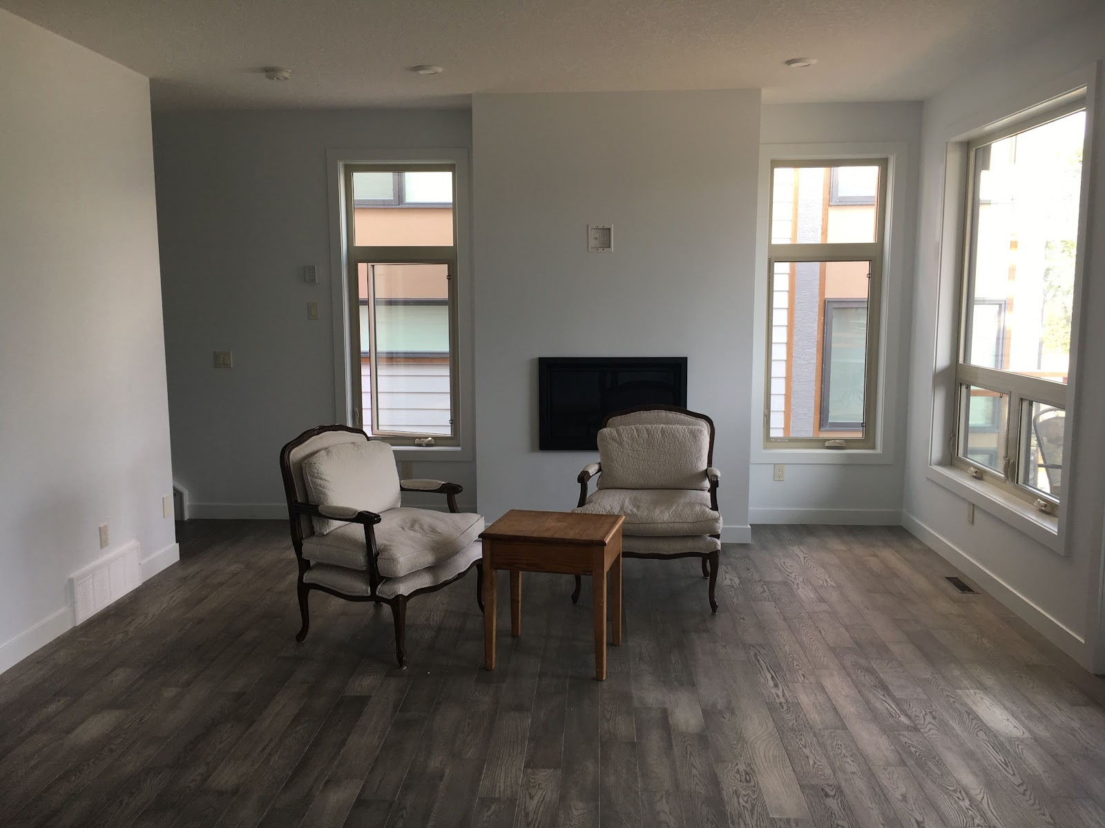 before: living room in calgary with wood floors and great lighting
