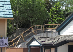 Photo: New trees have been added to the berm that separates Fantasyland from Liberty Square