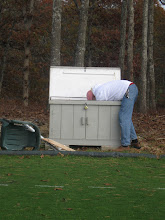 Photo: Courtenay cleans out the old storage bin.