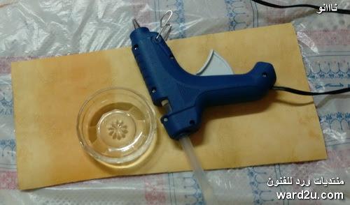 حامل مسدس الشمع من خامات البيئة