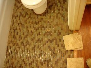 Photo: glass tile on bathroom floor