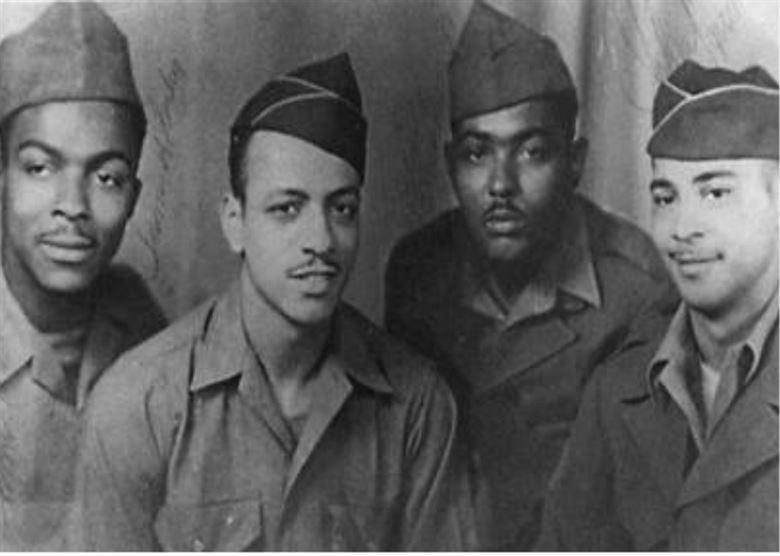 Members of C Company, 514th Truck Regiment. From left, James H. Bailey, Clarence Bainsford, Jack R. Blackwell, and John R. Houston. John Houston is the father of the late singer/actress Whitney Houston, and runs a company created by her. (Courtesy of the U.S. Army Transportation Museum)
