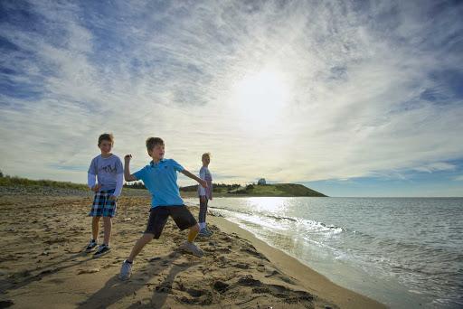 Beach-children-throwing-rocks.jpg - Local children throw rocks on a stretch of beach in Halifax, Nova Scotia.