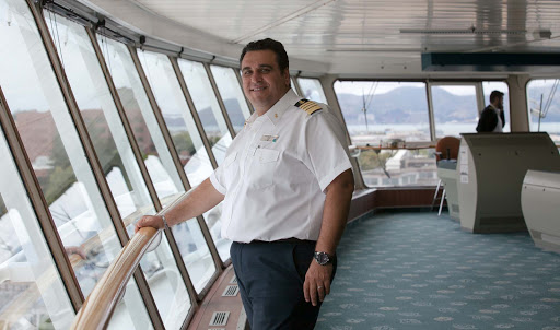 Celebrity-Infinity-captain-on-bridge - Captain Michael Sympouras on the bridge of Celebrity Infinity before a 12-day San Francisco-to-Alaska sailing.