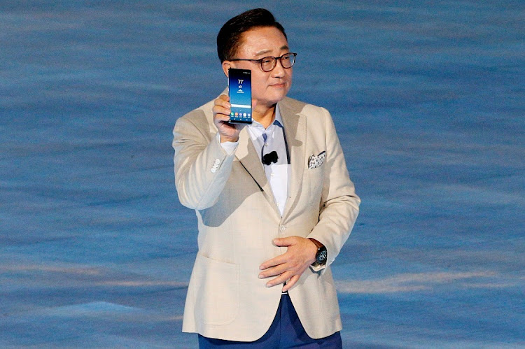 Koh Dong-jin, president of mobile communications at Samsung Electronics, shows the Galaxy Note 8 smartphone during the launch event in New York on Wednesday. Picture: REUTERS