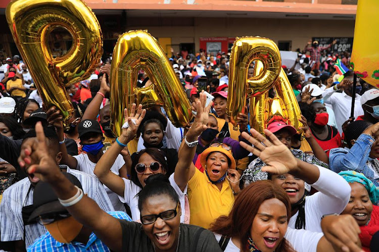 Enlightened Christian Gathering (ECG) supporters hold balloons spelling 'papa' after Shepherd Bushiri was granted bail.