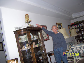 Photo: Dad is pointing to that chair.  He found it somewhere in his travels in Europe.  This china closet is now in my apartment.  I cherish it.